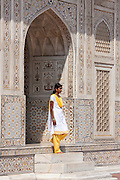 Muslim Punjabi girl at Tomb of Etimad Ud Doulah, 17th Century Mughal tomb built 1628, Agra, India