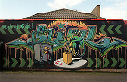 "© Licensed to London News Pictures.  02/11/2017; Bristol, UK. FILE PICTURE dated early 2000. ""Slick on Brick"", an early work by graffiti artist Banksy showing a monkey with a detonator blowing up a safe, painted on a garage wall of a house in Easton Bristol which is being auctioned this evening, 02/11/2017. The existence of the Banksy work may affect the bidding for the house beyond the guide price of £250,000 to £300,000, some experts suggest the sale could fetch far more, up to £1million. The piece was painted before Banksy's first formal show of work at the Severnshed restaurant from 29 February to 02 April 2000. The work was subsequently painted over and the owner of the house commissioned a new mural by artist 3rdEye. It is not known how much of the original Banksy piece is underneath the subsequent layers of paint or whether it can be restored. Picture credit : Simon Chapman/LNP"