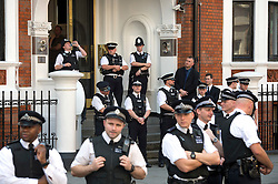 © Licensed to London News Pictures. 19/08/2012. POlice guard the entrance to the Ecuador Embassy before  Wikileaks founder Julian Assange gives a speech from a balcony at The Ecuador Embassy in London on August 19/08/2012. Assange, who faces arrest by British police if he leaves the building, took refuge in the embassy on June 19 to evade extradition to Sweden where he is wanted for questioning over alleged sexual misconduct. Photo credit : Ben Cawthra/LNP