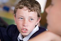 Teenager boy in class,