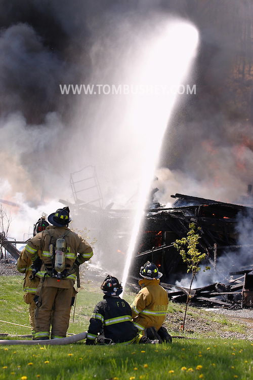 Goshen, N.Y. - Firefighters spray water on a fire that destroyed a two-story house on April 29, 2006. ©Tom Bushey/The Image Works