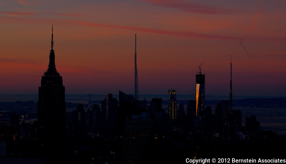 Pastel colors streak across the sky in the early morning hours over lower Manhattan.
