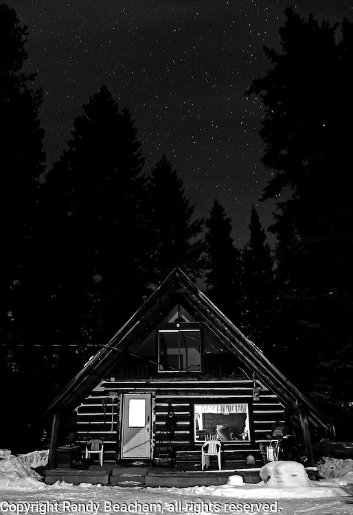 Log cabin and stars at night. Yaak Valley in the Purcell Mountains, northwest Montana.