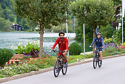 ROTTACH-EGERN, GERMANY - Thursday, July 27, 2017: Liverpool's Mohamed Salah cycles back from training from the Seehotel Uberfahrt on the banks of Lake Tegernsee on day two of their preseason training camp in Germany. (Pic by David Rawcliffe/Propaganda)