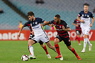 SYDNEY, AUSTRALIA - APRIL 27: Melbourne Victory midfielder Terry Antonis (8) dribbles the ball under pressure from Western Sydney Wanderers defender Tarek Elrich (21) and Western Sydney Wanderers defender Raul Llorente (24) at round 27 of the Hyundai A-League Soccer between Western Sydney Wanderers FC and Melbourne Victory on April 27, 2019 at ANZ Stadium in Sydney, Australia. (Photo by Speed Media/Icon Sportswire)