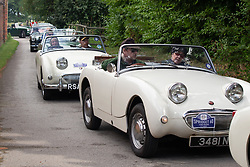 © Licensed to London News Pictures. 25/08/2018. Warwick, UK. The Midget & Sprite Club celebrated the 60th anniversary of the first Frogeye Sprite. Over 300 Sprites and Midgets arrived in Warwick to take part in a gala dinner and 100 mile drive through the Cotswolds. Pictured, Sprites line up for the drive out into the cotswolds. Photo credit: Dave Warren/LNP