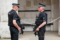 © Licensed to London News Pictures. 23/05/2017. London, UK. Armed police patrol at Horse Guards Parade in London on Tuesday 23 May 2017 following a terrorist attack that killed 22 and injured 59 people amongst children at Manchester Arena. Photo credit: Tolga Akmen/LNP