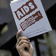 "Hand holding up ""AIDS awareness brochure"", safe sex, knowledge, understanding, protection - NYC"