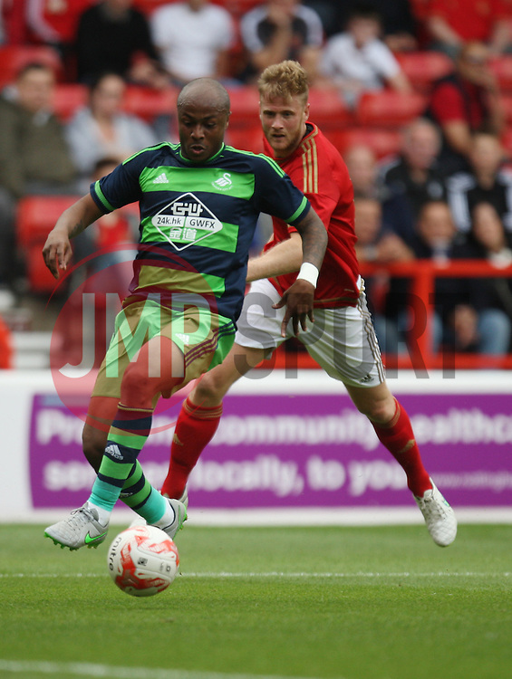 Andre Ayew in action before scoring Swansea's first goal<br /> <br />  - Mandatory by-line: Jack Phillips/JMP - 25/07/2015 - SPORT - FOOTBALL - Nottingham - The City Ground - Nottingham Forest v Swansea - Pre-Season Friendly