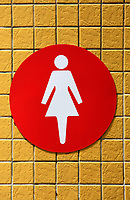 women restroom signal on the yellow ceramic background