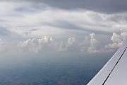 clouds and wing of airplane with line do not cross the line