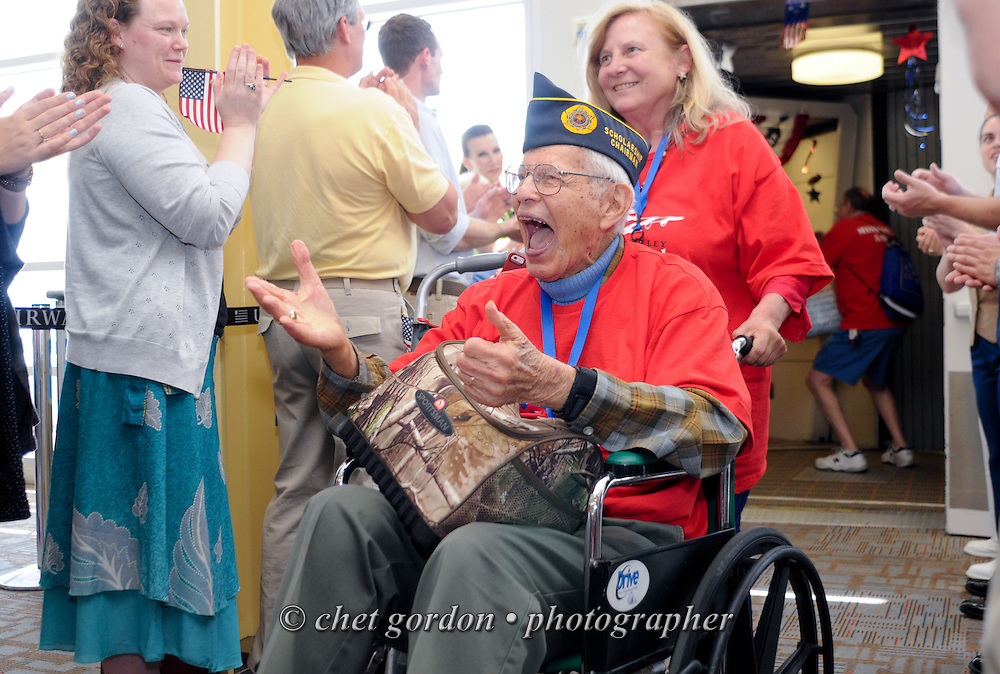 WWII Veterans and their escorts onboard the Hudson Valley Honor Flight #8 arrive at Reagan National Airport in Arlington, VA on Saturday, May 9, 2015. Sixty-six veterans from the Westchester County (NY) area toured the WWII and Marine Corps War Memorials, as well as Arlington National Cemetery. Hudson Valley Honor Flight is a chapter of the Honor Flight Network, which provides free flights for WWII Veterans and tours of the WWII Memorial constructed in their honor, and other sites in the nation's capital.  © Chet Gordon / Hudson Valley Honor Flight