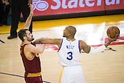 Golden State Warriors forward David West (3) protects the ball against Cleveland Cavaliers forward Kevin Love (0) at Oracle Arena in Oakland, Calif., on January 16, 2017. (Stan Olszewski/Special to S.F. Examiner)