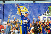 Brad Keselowski and team Miller Lite Dodge celebrate their win in the Geico 300 for the Geico 300 Sprint Cup Series at Chicagoland Speedway, Sunday, September 16th, 2012 in Joilet, IL l Gary Middendorf~for Sun-Times Media