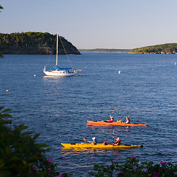 Sea kayakers in Frenchman Bay as seen from the Shore Path in Bar Harbor.Maine..