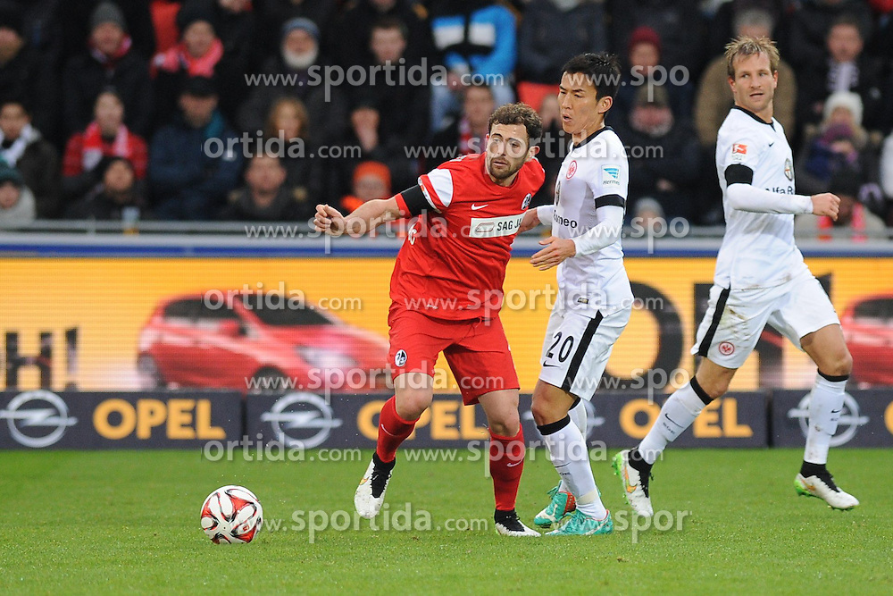 31.01.2015, Schwarzwald Stadion, Freiburg, GER, 1. FBL, SC Freiburg vs Eintracht Frankfurt, 18. Runde, im Bild (l.) Admir Mehmedi (SC Freiburg) im Zweikampf, Aktion, mit (r.) Makoto Hasebe (Eintracht Frankfurt) // during the German Bundesliga 18th round match between SC Freiburg and Eintracht Frankfurt at the Schwarzwald Stadion in Freiburg, Germany on 2015/01/31. EXPA Pictures &copy; 2015, PhotoCredit: EXPA/ Eibner-Pressefoto/ Laegler<br /> <br /> *****ATTENTION - OUT of GER*****
