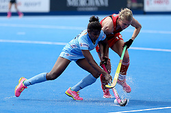 England's Alex Danson (right) and India's Sunita Lakra battle for the ball during the Vitality Women's Hockey World Cup pool B match at The Lee Valley Hockey and Tennis Centre, London.