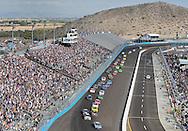 Nov. 12 2011; Avondale, AZ, USA; NASCAR Nationwide Series driver Aric Almirola (88) leads Carl Edwards (60) and the pack during the Wypall 200 at Phoenix International Raceway. Mandatory Credit: Jennifer Stewart-US PRESSWIRE
