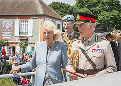 © Licensed to London News Pictures. 05/06/2014.  HRH the Prince of Wales walks over Pegasus bridge this afternoon with the Duchess of Cornwall as part of the 70th Anniversary of the D Day landings in Normandy.  Photo credit : Alison Baskerville/LNP