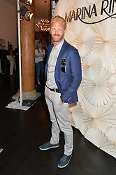 ALASTAIR GUY at the launch of the new Marina Rinaldi flagship store at 5 Albemarle Street, London on 3rd July 2014.