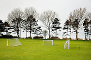 A soccer field nestles a few meters from the ocean front.