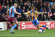 James Collins of Shrewsbury Town against David Mirfin of Scunthorpe United during the Sky Bet League 1 match between Scunthorpe United and Shrewsbury Town at Glanford Park, Scunthorpe, England on 17 October 2015. Photo by Ian Lyall.