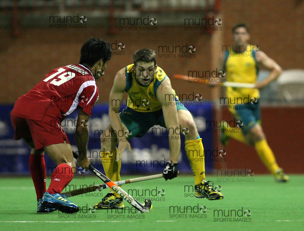 (Canberra, Australia---29 March 2012) Graeme Begbie of the Australia Kookaburra national field hockey team playing in the first of a three game test series against Japan. 2012 Copyright Photograph Sean Burges / Mundo Sport Images.