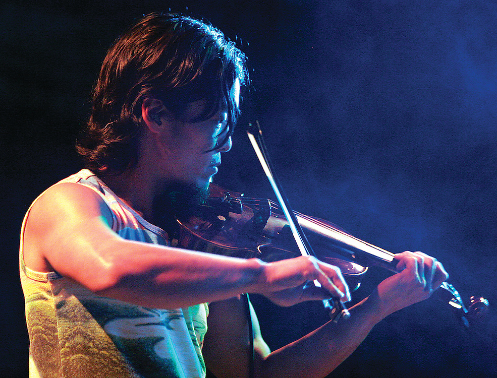 The String Cheese Incident's Michael Kang gets down on the violin Thursday evening at the Alabama Theatre in Birmigham. / Elliot Knight