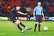 Ryan Hedges of Barnsley (7) shoots during the EFL Sky Bet League 1 match between Doncaster Rovers and Barnsley at the Keepmoat Stadium, Doncaster, England on 15 March 2019.