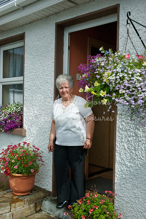 Eileen Daniels garden owner in Father McDyer Terrace, Glencolmkille, Co. Donegal, Ireland