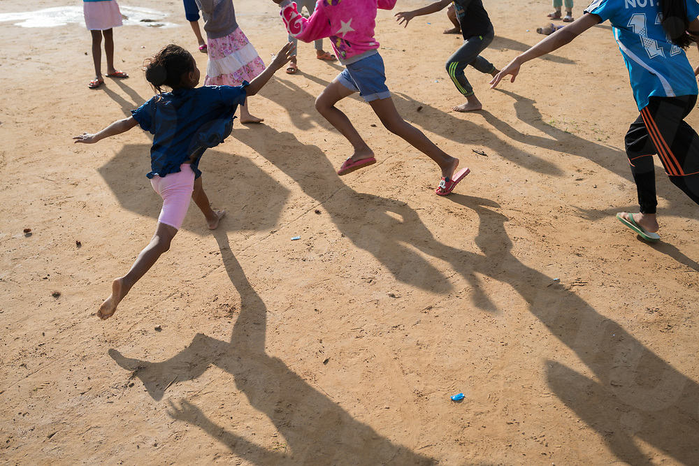 August 04, 2018 - Attapeu (Laos). Kids play in the football field of the primary school of Sanamxai. The bulding is one of the provisional relocation sites used by Lao authorites to host more than 3000 people who have been displaced from the villages affected by the collapse of the dam. © Thomas Cristofoletti / Ruom