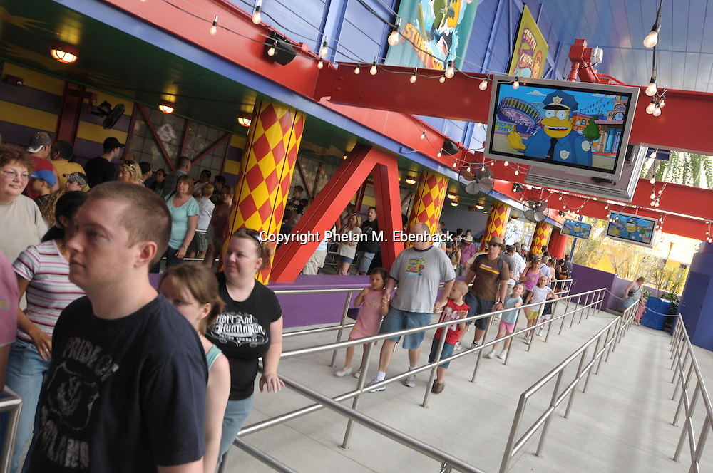 Tourists make their way through the queue for The Simpson's Ride at the Universal Studios Orlando theme park in Orlando, Florida.