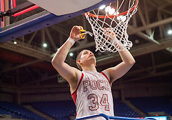 Poca guard Noah Frampton (34) cuts down the nets after winning the Class AA championship game at the Charleston Civic Center.