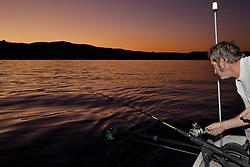 """""""Fishing Lake Tahoe at Sunset 1"""" - This man was photographed fishing for Mackinaw on Lake Tahoe at sunset."""