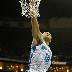 Jan 21, 2013; New Orleans, LA, USA; New Orleans Hornets shooting guard Eric Gordon (10) dunks against the Sacramento Kings during the second quarter of a game at the New Orleans Arena. Mandatory Credit: Derick E. Hingle-USA TODAY Sports