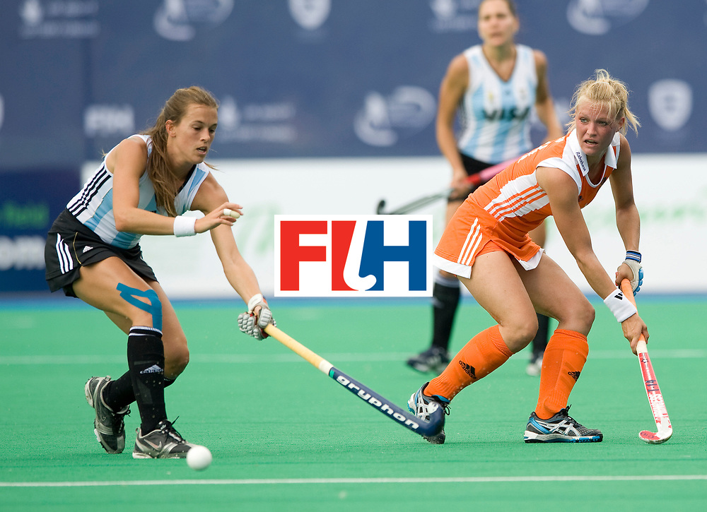 Netherlands' Sophie Polkamp clears under pressure from Argentina's Carla Rebecchi during their Women's Champions Trophy Final at Highfields, Beeston, Nottingham, 18th July 2010.