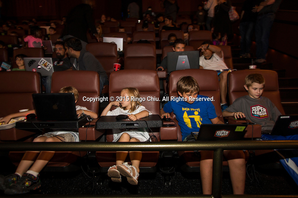 Kids playing games on Super League Gaming in Cinemark Playa Vista.(Photo by Ringo Chiu/PHOTOFORMULA.com)