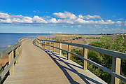 Boardwalk along the dunes adjacent the saltwater beach at the Irving Eco-centre <br /> Bouctouche<br /> New Brunswick<br /> Canada