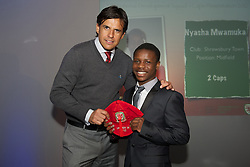 CARDIFF, WALES - Saturday, May 11, 2013: Nyasha Mwamuka is presented with his U16's cap by Wales national team manager Chris Coleman at the FAW Trust Under-16's cap presentation. (Pic by David Rawcliffe/Propaganda)