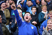 Cardiff City fan celebrating opening goal during the Sky Bet Championship match between Fulham and Cardiff City at Craven Cottage, London, England on 9 April 2016. Photo by Matthew Redman.