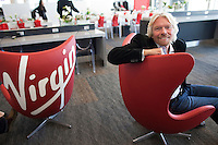 Sir Richard Branson, founder of Virgin Group Limited, sits in the new Terminal 2 at the San Francisco International Airport in San Francisco, California, U.S., on Wednesday April 6, 2011. Photographer: David Paul Morris/Bloomberg