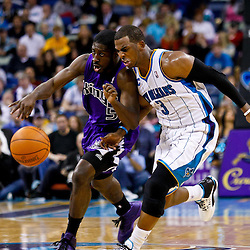 December 15, 2010; Sacramento Kings point guard Pooh Jeter (5) is defended by New Orleans Hornets point guard Chris Paul (3) during the second half at the New Orleans Arena. The Hornets defeated the Kings 94-91. Mandatory Credit: Derick E. Hingle
