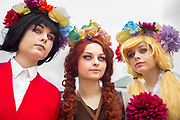 UNITED KINGDOM, London: 25 May 2018 (Left to right) Sisters Bethia, Melody and Tyler Henno pose for a picture at MCM London Comic-Con this afternoon. The three day comic convention, which is held at London's ExCeL, will see thousands of visitors many of them in cosplay, dressed as their favourite super hero, villain or comic book character. Rick Findler  / Story Picture Agency