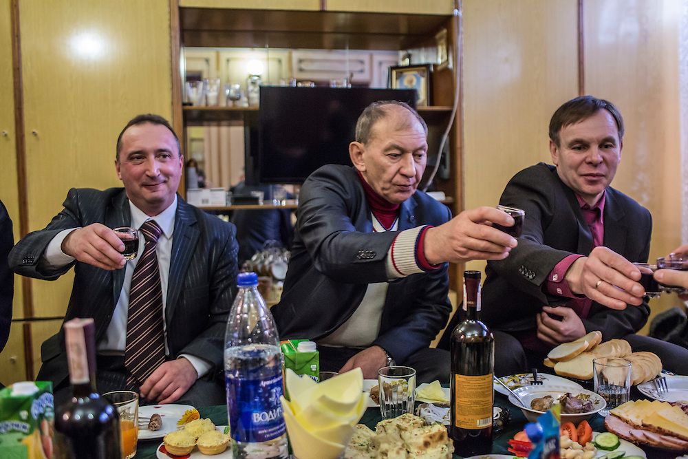 Sergei Stoliarchuk, Georgii Dolzhenko, and Igor Novoselov, from left, executives at the Zolote Coal Mine, toast visiting journalists on Tuesday, February 9, 2016 in Zolote, Ukraine. The mine is one of the oldest in the region, having first opened in 1905.