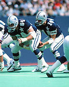 Dallas Cowboys center Tom Rafferty (64) snaps the ball to Dallas Cowboys quarterback Gary Hogeboom (14) during the NFL football game against the New York Giants on Sept. 9, 1984 in East Rutherford, N.J. The Giants won the game 28-7. (©Paul Anthony Spinelli)