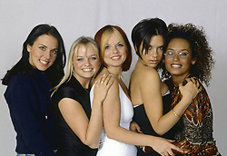 British girl band The Spice Girls posing smiling on a photo set. The band is formed by British singer-songwriter and writer Geri Halliwell, British singer-songwriter Melanie C (Melanie Chisholm), British singer and actress Mel B (Melanie Janine Brown), British singer, fashion designer and model Victoria Beckham (Victoria Adam) and British singer-songwriter and TV presenter Emma Bunton. 1998 (Credit Image: © Rino Petrosino/Mondadori Portfolio via ZUMA Press)