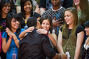 25 AUGUST 2008 -- PHOENIX, AZ: Puerto Rican reggaeton star DADDY YANKEE (real name Ramon Ayala) hugs girls at Central High School in Phoenix Monday. Daddy Yankee was there on behalf of Sen John McCain. US Sen John McCain (R-AZ), the presumptive Republican nominee for President, visits Central High School in downtown Phoenix, AZ, Monday, Aug 25. McCain  campaigned with Puerto Rican hip hop, reggaeton star Daddy Yankee (Ramon Ayala). Central High School is one of the most diverse high schools in Phoenix. More than 50 languages are spoken by students at the school.       PHOTO BY JACK KURTZ