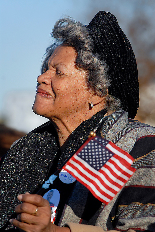 A supporter of presidential candidate Barack Obama, listens to the candidate during a campaign speech in Herndon, VA.