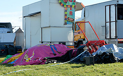 "© Licensed to London News Pictures. 27/03/2016. London, UK. A general view of the bouncy castle where a girl died that she was playing in when it ""blew away by some distance"". Two people are being held on suspicion of manslaughter by gross negligence following the incident which took place in Harlow Town Park in Essex. Photo credit : Hannah McKay/LNP"