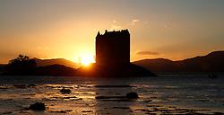 Castle Stalker on the west coast of Scotland silhouetted by the setting autumnal sun ....... (c) Stephen Lawson | Edinburgh Elite media